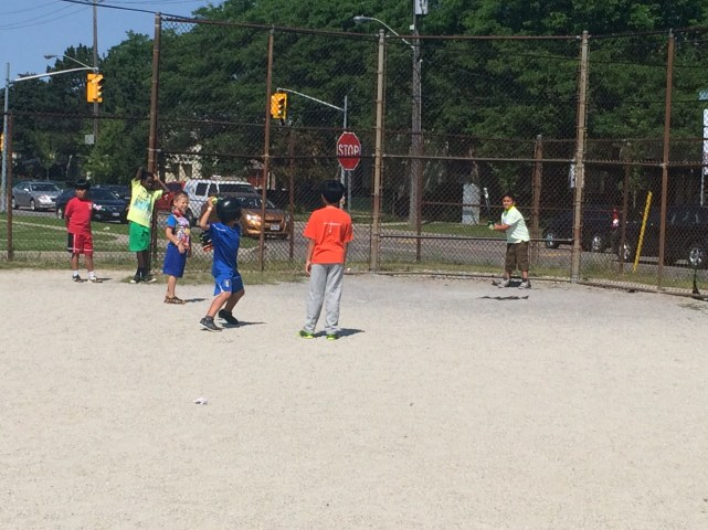 Campers playing baseball.