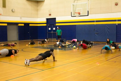 Campers dropping down and learning how to do proper push ups