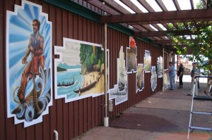 Airbrushed paintings depicting the history of Paihia and Waitangi are featured on the back wall of the Williams road shops. Artist David Lattimer