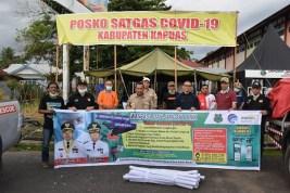 Pemkab Terima Bantuan Spanduk Himbauan Covid-19 dari BSM KCP Kapuas