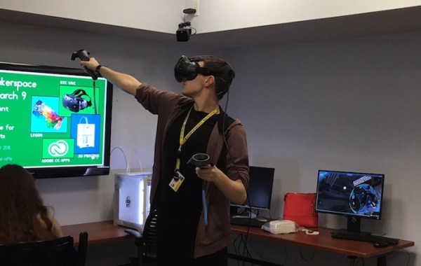 Student experiencing Virtual Reality in the MakerSpace