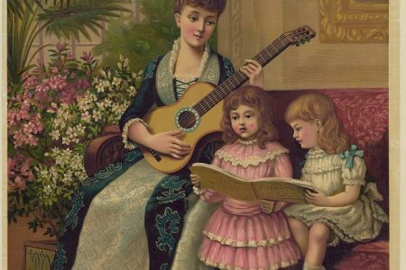 A mother plays the guitar while her two daughters sing a carol.