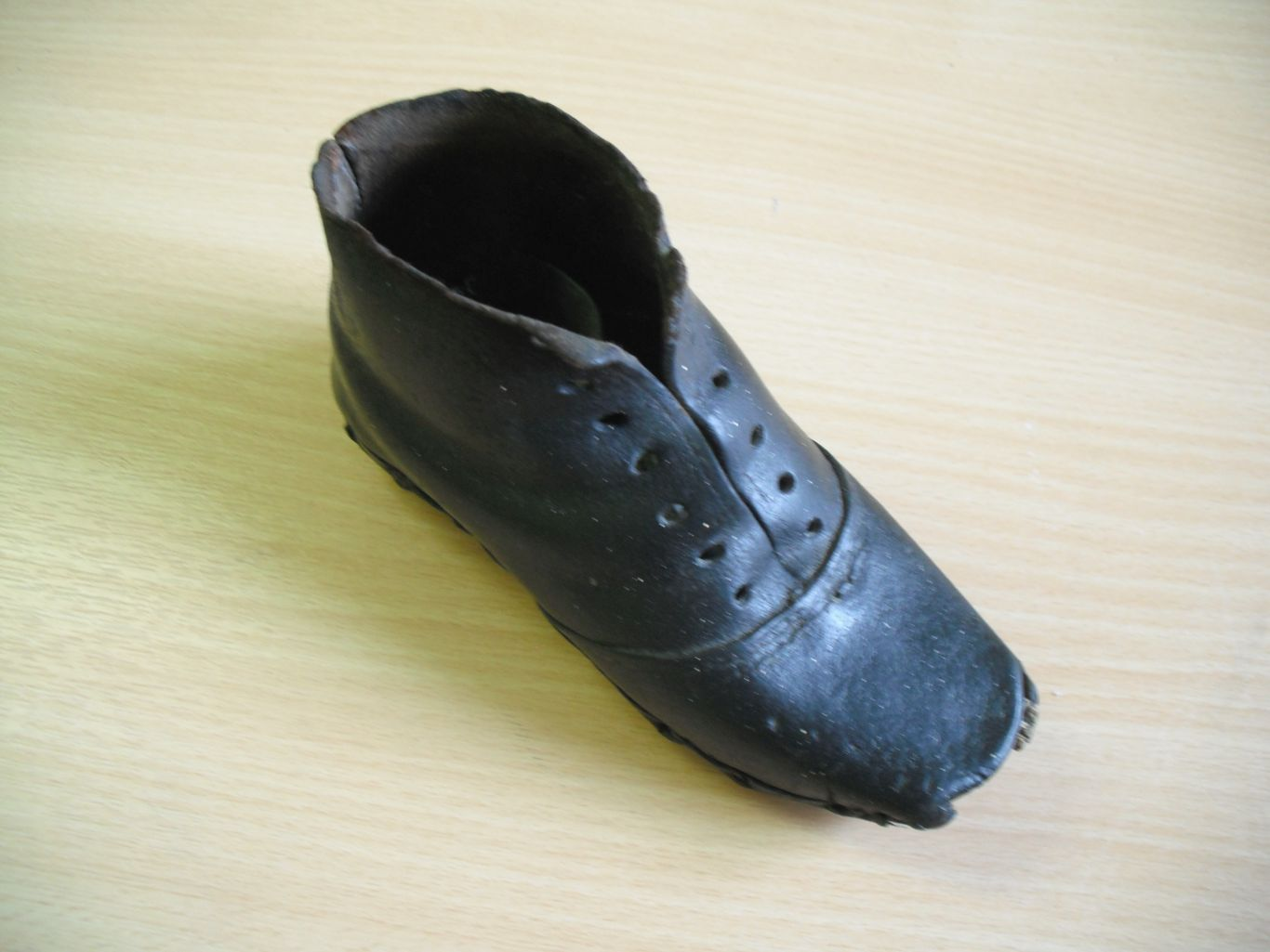 Figure 1. An 18th/19th-century child's shoe found in the chimneybreast of a house in Ilkley, Yorkshire. Photograph by C. Houlbrook, April 2011