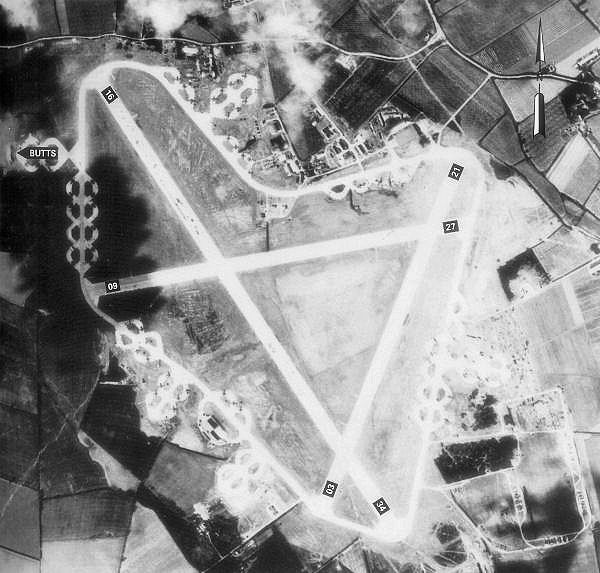 Boreham Airfield. Dukes Wood, one potential location for the 'witches stone' passed vertically through the middle of this site © By British Government - Royal Ordinance Survey. Crown Copyright expired 50 years after photograph taken in 1944. Annotations on photo from Freeman, Roger A., UK Airfields of the Ninth: Then and Now (Original uploader: Bwmoll3 - 2009 https://commons.wikimedia.org/w/index.php?curid=18179201)