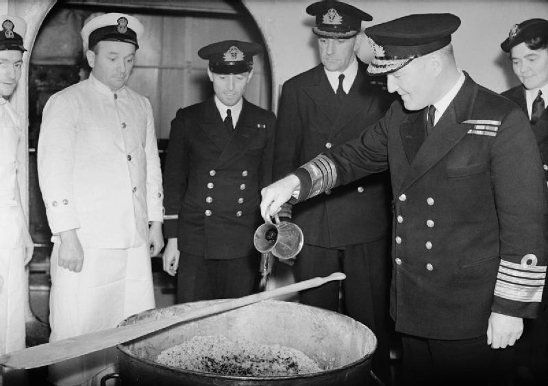 Admiral Sir Bruce Fraser pouring the rum into the Christmas pudding mix on board HMS DUKE OF YORK, November 1943. By Royal Navy official photographer - http://media.iwm.org.uk/iwm/mediaLib//30/media-30365/large.jpgThis is photograph A 20183 from the collections of the Imperial War Museums., Public Domain, https://commons.wikimedia.org/w/index.php?curid=25087385
