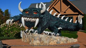 Photograph of statue of horned hodag monster