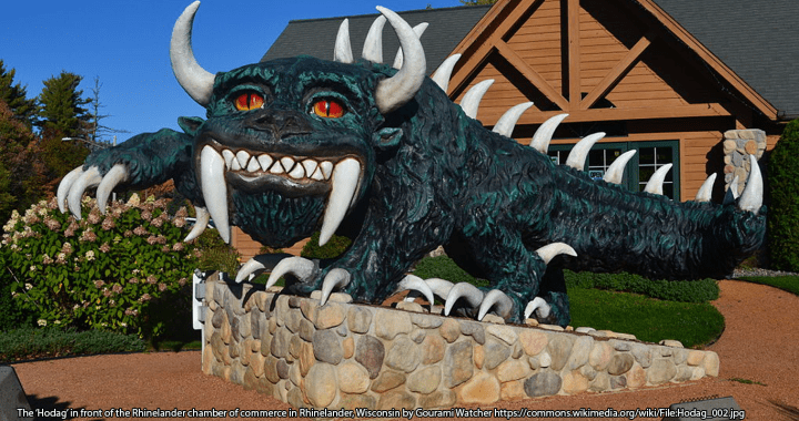 Photograph of statue of horned hodag monster