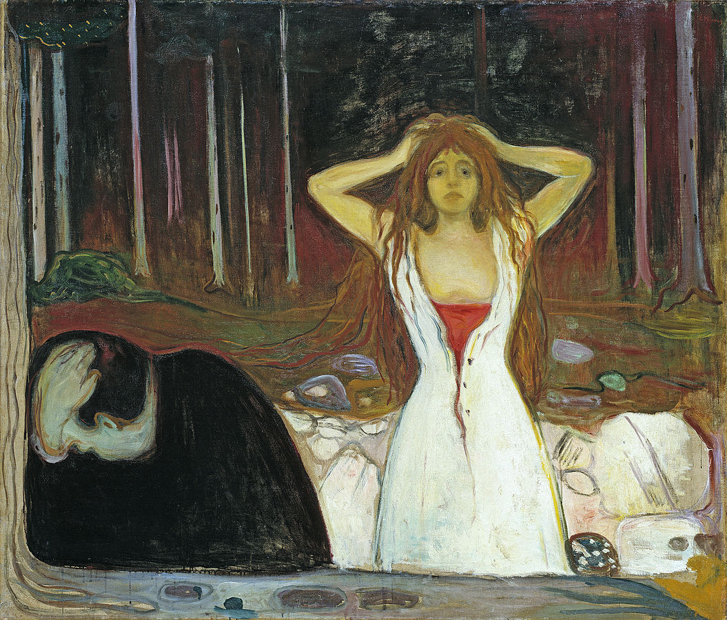 Man holds his head, as a woman stands behind him in the wood.