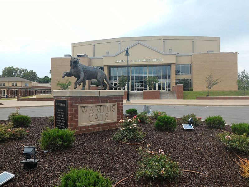 Photo of a wampus cat staue in front of a building