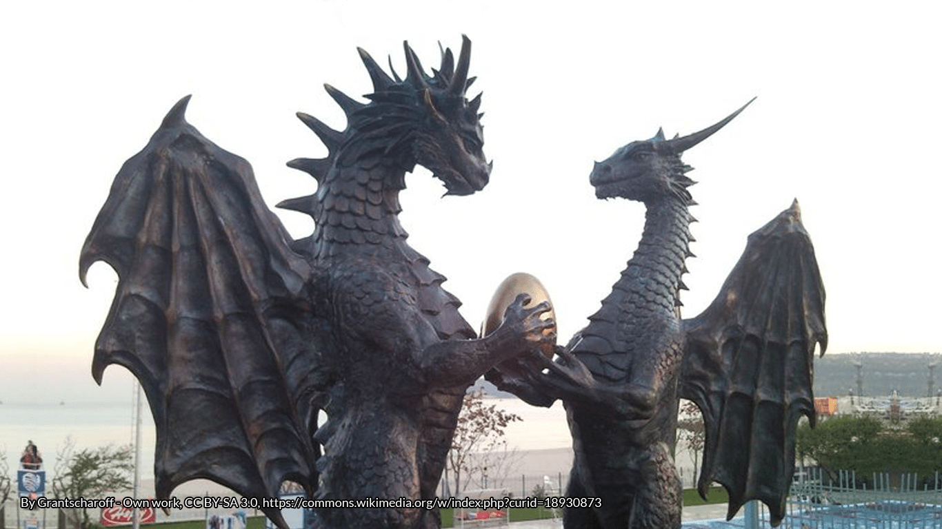 Statues of male and female dragons holding a dragon egg at Varna seaside