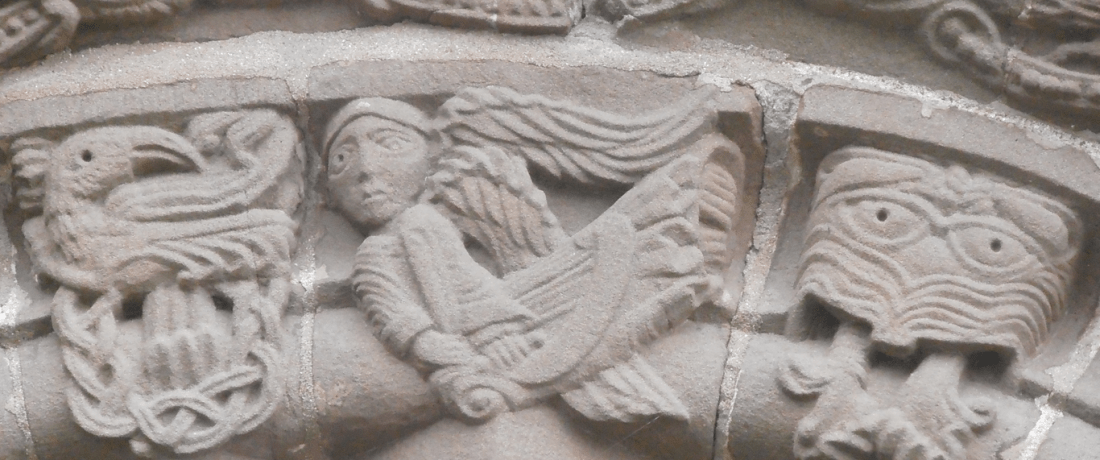 A harp-playing angel accompanied by two fearsome companions © Anne O'Brien