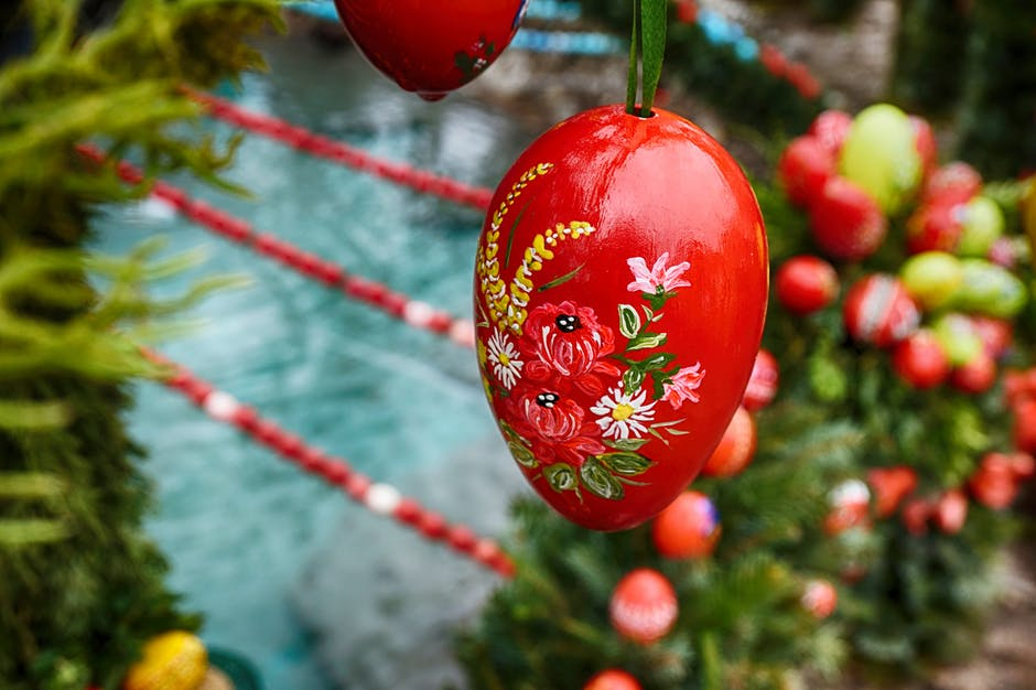 A painted red Easter egg. https://www.pexels.com/photo/red-easter-egg-flower-65764/
