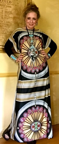 In the center of the radiating sun design of this caftan is a Kachina. It is that of a woman. Above the female Kachina is the male. I like to think of them as Frida and Diego caught in the lightening flashes and the sun's rays.