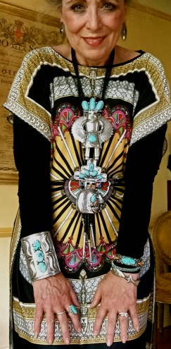 A vintage Navajo turquoise and sterling silver bow guard in on my right wrist and Navajo bracelets on the left. A closer view of the Kachina pendants, too.