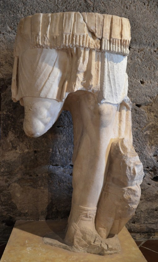 Fragment of a colossal statue of Hadrian wearing a cuirass with a barbarian kneeling a this feet, from the temple area, Hierapolis Archaeology Museum, Turkey
