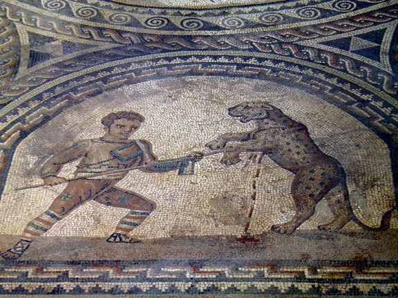 Detail of the Gladiator mosaic floor, a Venator fighting a leopard, Römerhalle, Bad Kreuznach Carole Raddato