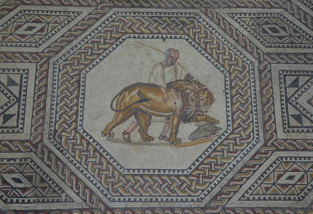 Medallion depicting a resentful lion being led away by his aged keeper, the gladiator mosaic at the Roman villa in Nennig, Germany © Carole Raddato