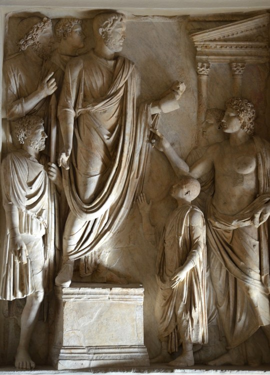 Relief from the Arch of Portugal (Arco di Portogallo): Hadrian's donation of food to Roman children, Palazzo Nuovo, Capitoline Museums © Carole Raddato