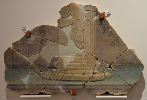 Fresco fragment in the Third Pompeian Style with trompe-l'oeil architetural composition, from the Oppidum of Ruscino in Perpignan, Empire of colour. From Pompeii to Southern Gaul, Musée Saint-Raymond Toulouse © Carole Raddato