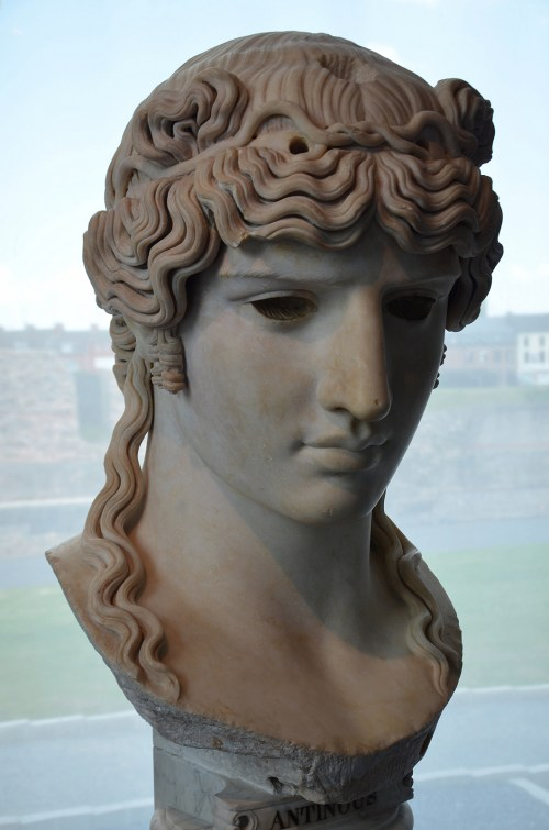 Head of Antinous that would have been part of a colossal statue with a wooden torso and marble extremities (acrolithic cult statue).