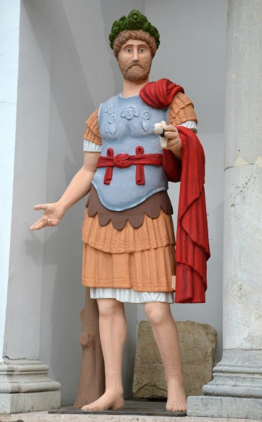Painted replica of a full length statue of Hadrian.