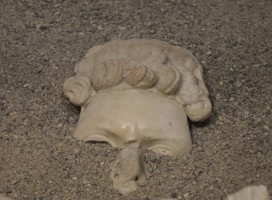 Forehead and upper parts of hair of a cuirassed statue of Hadrian