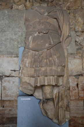 Marble torso of a Roman emperor, found in a room southeast of the Forum, on display in the Temple of Augustus