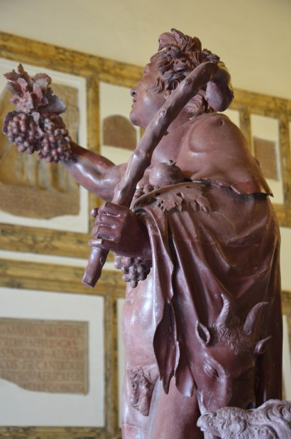 "Detail of the ""Fauno rosso"", a red-marble statue depicting a drunken satyr, Hadrianic copy of a Greek original from the late Hellenistic, from Hadrian's Villa, Palazzo Nuovo, Capitoline Museums"