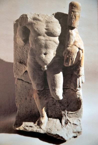 Stela depicting Hercules walking.