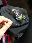 Sewing my camino forum badge onto my backpack