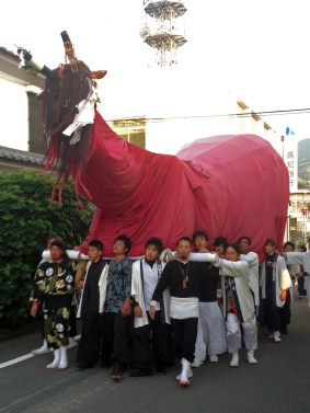 A bull float being pulled through the streets