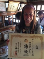 Holding my certificate of completion at Temple 88!!