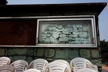 Photo wallpaper of rocks on a wooden shed