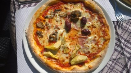 Real Italian pizza with olives in Trieste