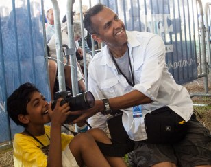 Richard Conde showing his son the camera magaic; the first time in the phot pit! http://www.richardcondephotos.com/