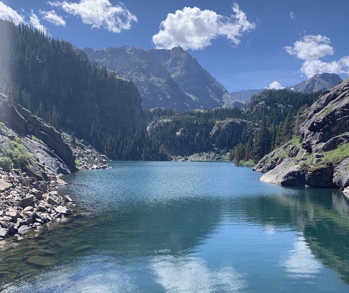 A beautiful blue lake surrounded by mountains