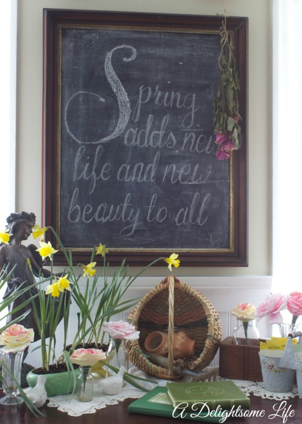 Romantic spring garden vignette and chalkboard