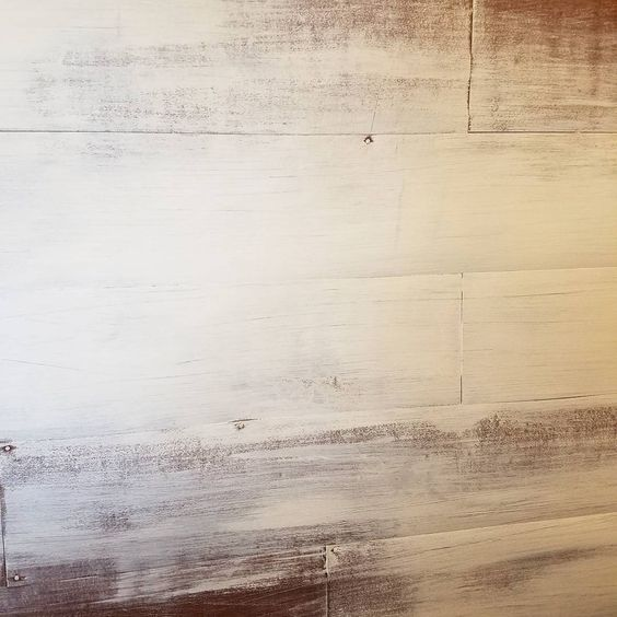 Whitewashed peel and stick vinyl flooring faux shiplap wall