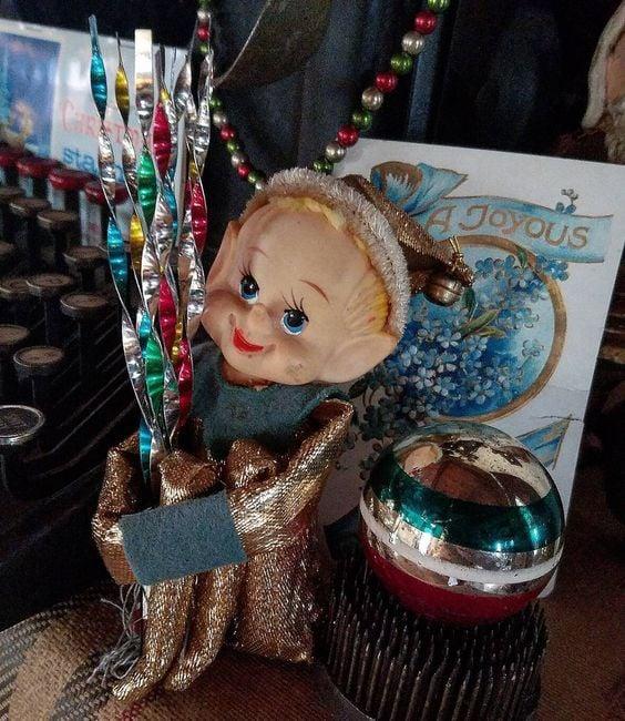 Vintage Knee Hugger Elf with vintage Icicle ornaments