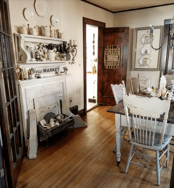 Gorgeous shabby chic farmhouse dining room faux fireplace faux mantel neutral decor