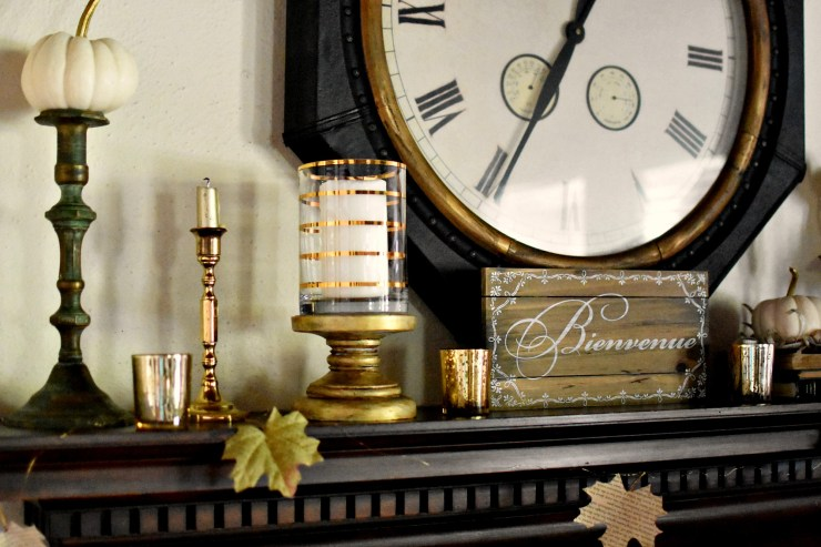 Beautiful fall mantel decor fall mantle with brass and gold candlesticks, book page leaf garland and