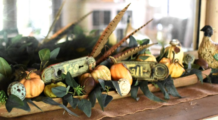 fall dough bowl display cute french pumpkins and eucalyptus in dough bowl with vintage hardware and pheasant feathers