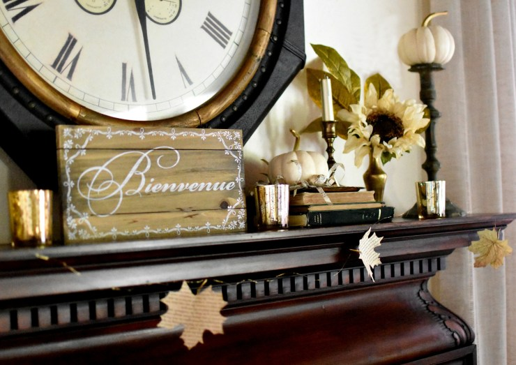 vintage cottage style fall home tour french country fall decor book page leaf garland fall mantel with vintage brass candlesticks white pumpkins mercury glass