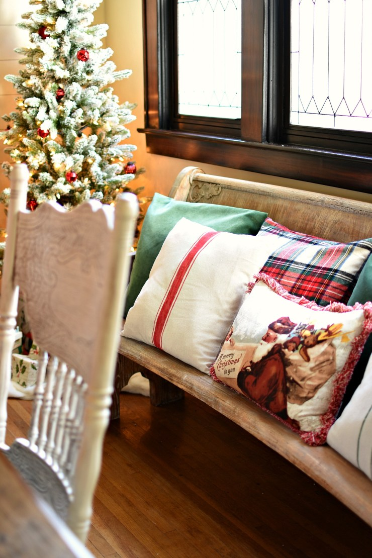Farmhouse Christmas Dining room vintage church pew with cute Christmas pillows