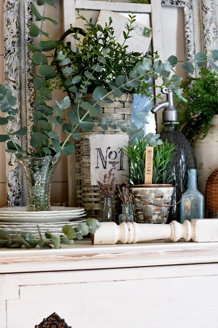French vintage vignette with found treasures vintage glass bottles ironstone fresh eucalyptus brocante