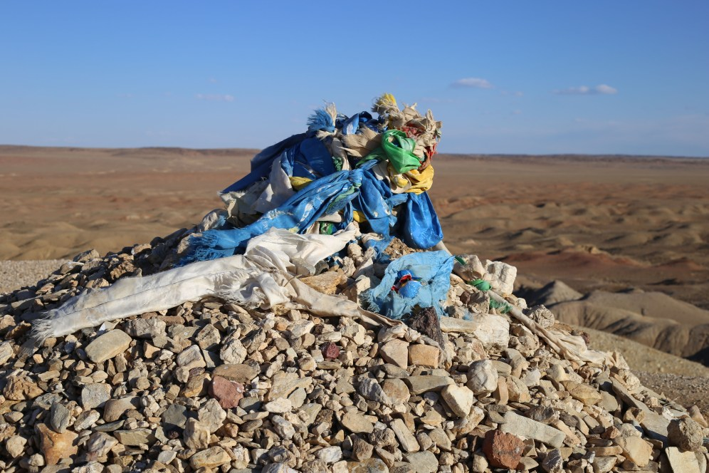 "The Gobi is sprinkled with ""ovoos"". These are sacred stone heap used as altar or shrine for religious purposes"