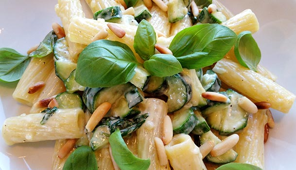 Creamy pasta with zucchini and pine-nuts