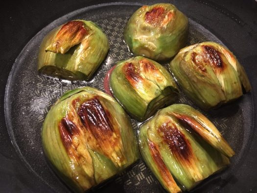 Artichokes roasting in the pan