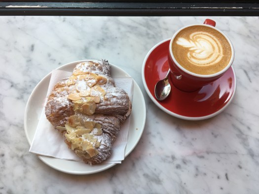 Almond croissant and flat white at Soho Grind