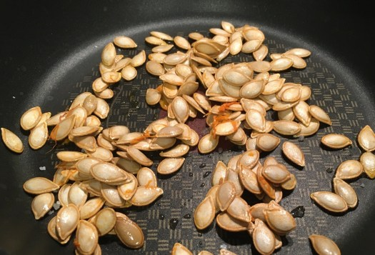 Butternut squash seeds on a pan, still uncooked